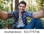 Man Sitting And Makes Selfie In ...