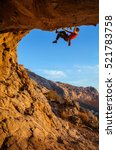 male climber on overhanging... | Shutterstock . vector #521783758