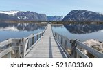 boardwalk into Western Brook Pond with mountains in Gros Morne National Park, Newfoundland