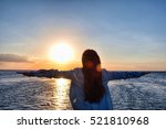 girl standing by the sea and... | Shutterstock . vector #521810968