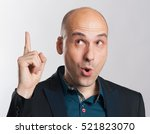 bald guy having a good idea.... | Shutterstock . vector #521823070