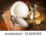 ripe half cut coconut on a... | Shutterstock . vector #521830459