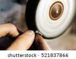 jeweler polishing jewelry with... | Shutterstock . vector #521837866
