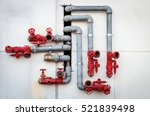 metal water pipes. red valves.... | Shutterstock . vector #521839498