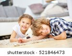 Two Happy Kids Playing With...