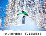 snowboarder freeride jump in... | Shutterstock . vector #521865868