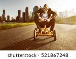 business man on a pedal car | Shutterstock . vector #521867248
