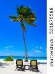 group deck chairs under an... | Shutterstock . vector #521875588