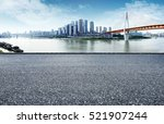 asphalt road next to the city... | Shutterstock . vector #521907244