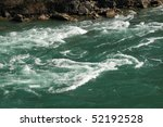 Niagara River - emerald water with white rapids - stock photo