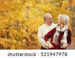 lovely mature couple in autumn... | Shutterstock . vector #521947978