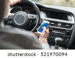 man using a smartphone while... | Shutterstock . vector #521970094