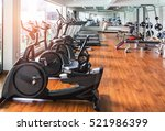 rows of stationary bike in gym... | Shutterstock . vector #521986399