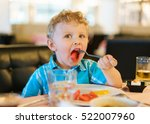 blond  curly haired kid in a... | Shutterstock . vector #522007960