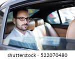 handsome business man in car.  | Shutterstock . vector #522070480