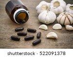Small photo of Garlic and garlic herbal capsules, alternative medicine