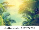 Stock photo palm trees against blue sky palm trees at tropical coast vintage toned and stylized coconut tree 522097750