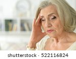 senior woman with thoughtful  | Shutterstock . vector #522116824