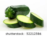 cut courgette or zucchini (Cucurbita pepo) on a white background - stock photo