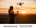 Man Operating A Drone With...