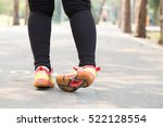 ankle sprain while jogging | Shutterstock . vector #522128554
