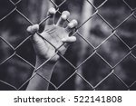 refugee children hand on fence. ... | Shutterstock . vector #522141808