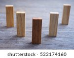 Small photo of A group of wood blocks forming steps to demonstrate of team position or business position.