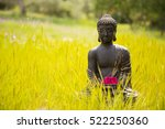 Buddha Figurine With Red...