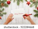 Woman Write Christmas Greeting...