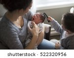 a happy mother holding adorable ... | Shutterstock . vector #522320956