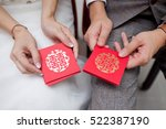 Wedding Couple Holding Red...