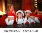 Children In Santa Hats Near Th...