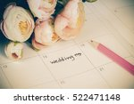 word wedding on calendar with... | Shutterstock . vector #522471148