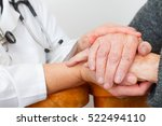 Small photo of Photo of a caregiver hand touching elderly patients hand