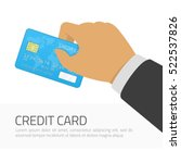 hand holding blue credit card... | Shutterstock .eps vector #522537826