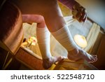 woman applying roll bandage on... | Shutterstock . vector #522548710