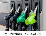 fuel pistols at petrol station. | Shutterstock . vector #522563803