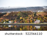 Small photo of Akureyri between autumn and winter season, Northern city of Iceland with beautiful landscape reflecting in water.