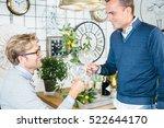side view of two men cheering... | Shutterstock . vector #522644170