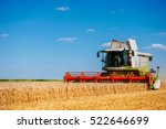 Combine Harvesting The Field O...