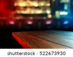 Stock photo wooden desk top of free space for your decoration and party light of red and blue color 522673930