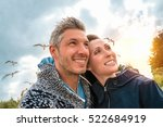 couple on the windy sea having... | Shutterstock . vector #522684919