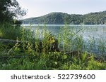 the lake fuschlsee with grass... | Shutterstock . vector #522739600