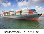 container ship leaving port | Shutterstock . vector #522744154