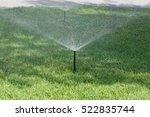 sprinkler spraying stream of... | Shutterstock . vector #522835744
