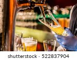 barman hands pouring a lager... | Shutterstock . vector #522837904