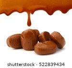 caramel candies and sauce... | Shutterstock . vector #522839434