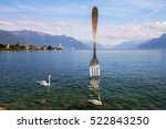 Small photo of VEVEY, SWITZERLAND - September 02: modern art, 8-metre (26-foot) tall giant fork sticking out of a Geneva lake. Vevey, Switzerland on September 02, 2016