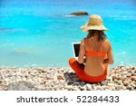 young woman using laptop on the ... | Shutterstock . vector #52284433