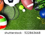 Small photo of Various sport tools on grass